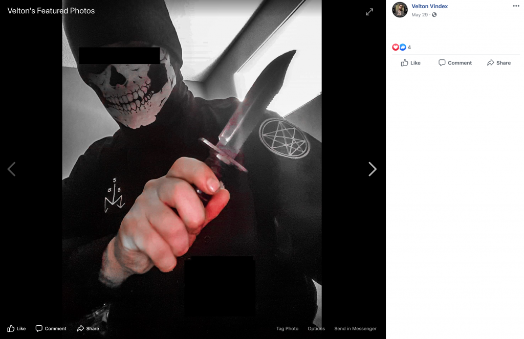 An image of an individual with eyes blurred out and face obscured by a skull mask holding a knife threateningly.